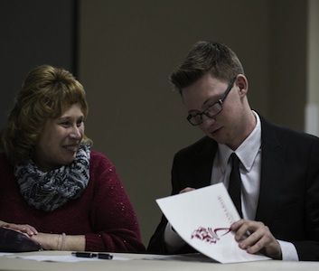 Rogers, pictured with his mother signs his letter of intent to RC.